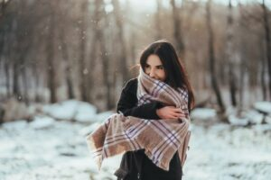 woman wearing scarf to protect skin in winter